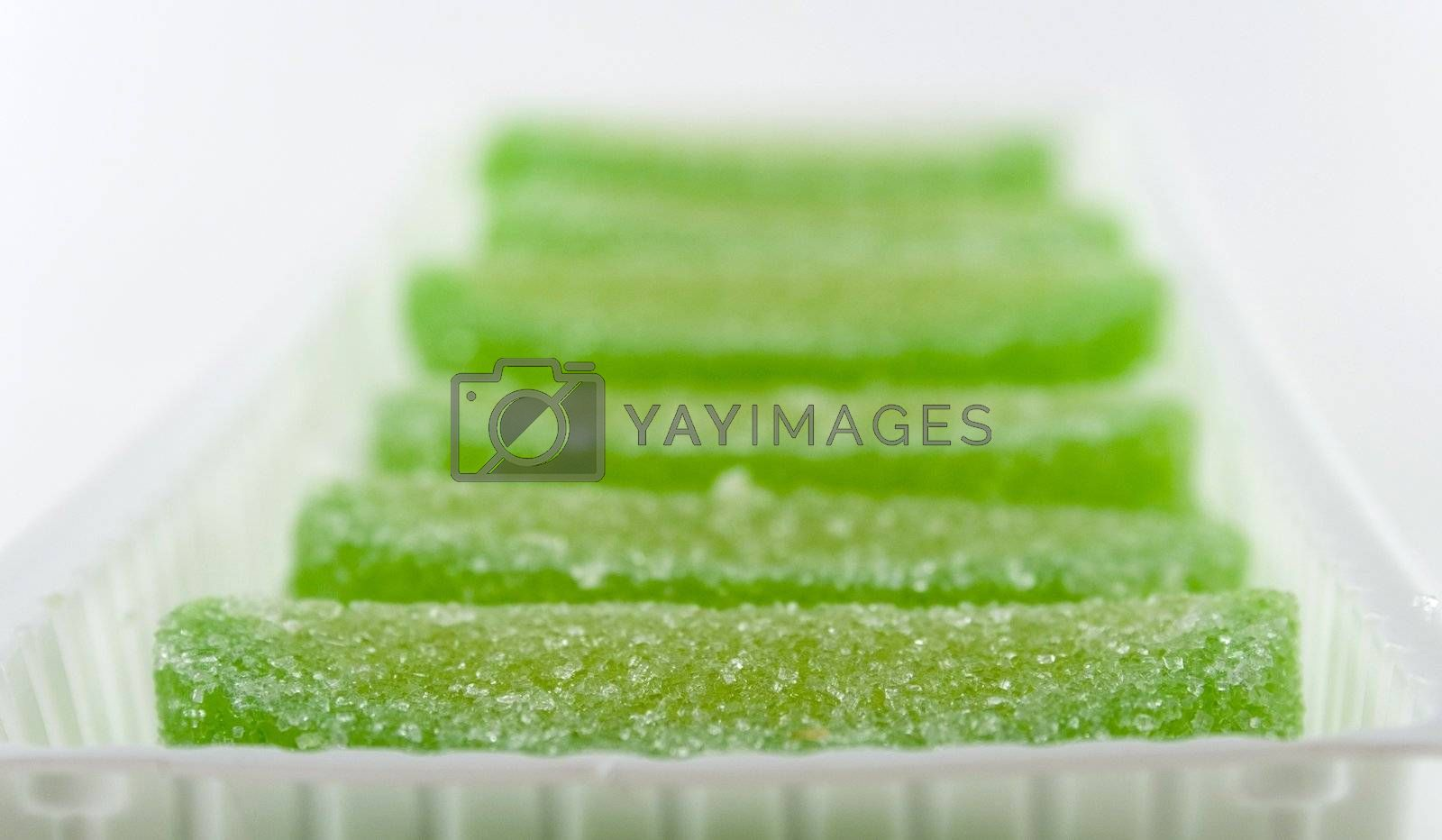green candies in white box