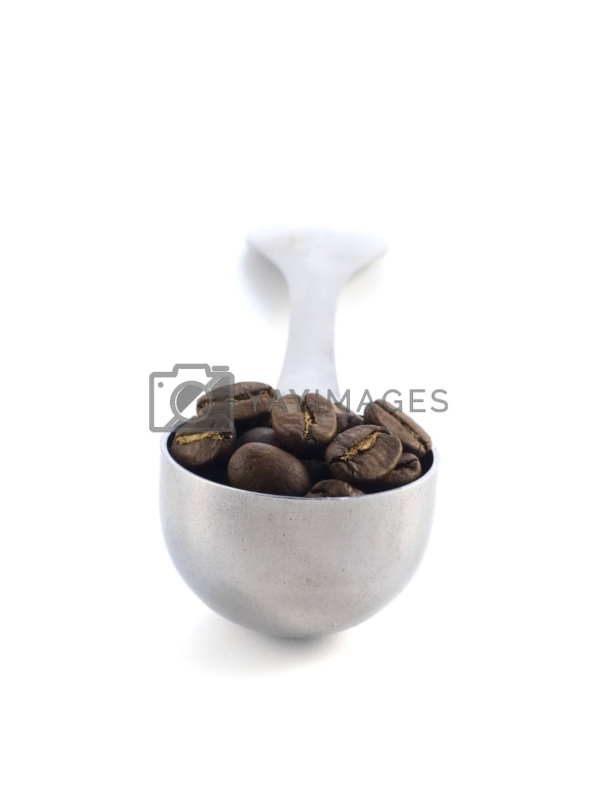 spoon full of coffee beans isolated on white background