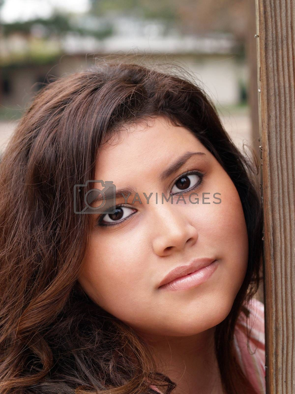 Outdoor portrait of pretty plus-size model neutral expression