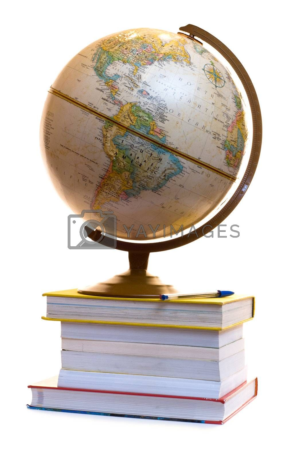 A model of the blobe sitting on a pile of text books, isolated on a white background
