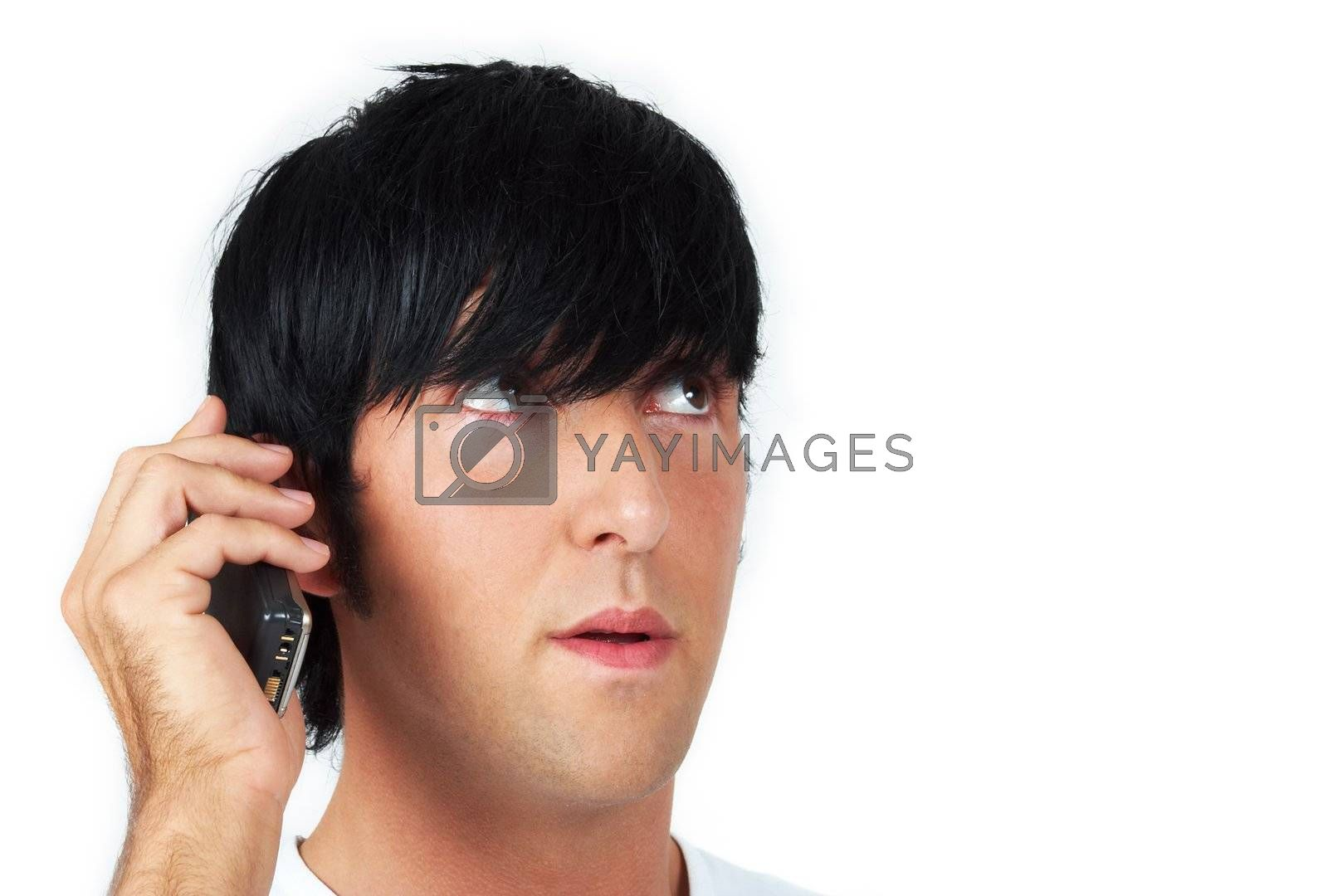 head shot of a hispanic guy speaking on his cellphone
