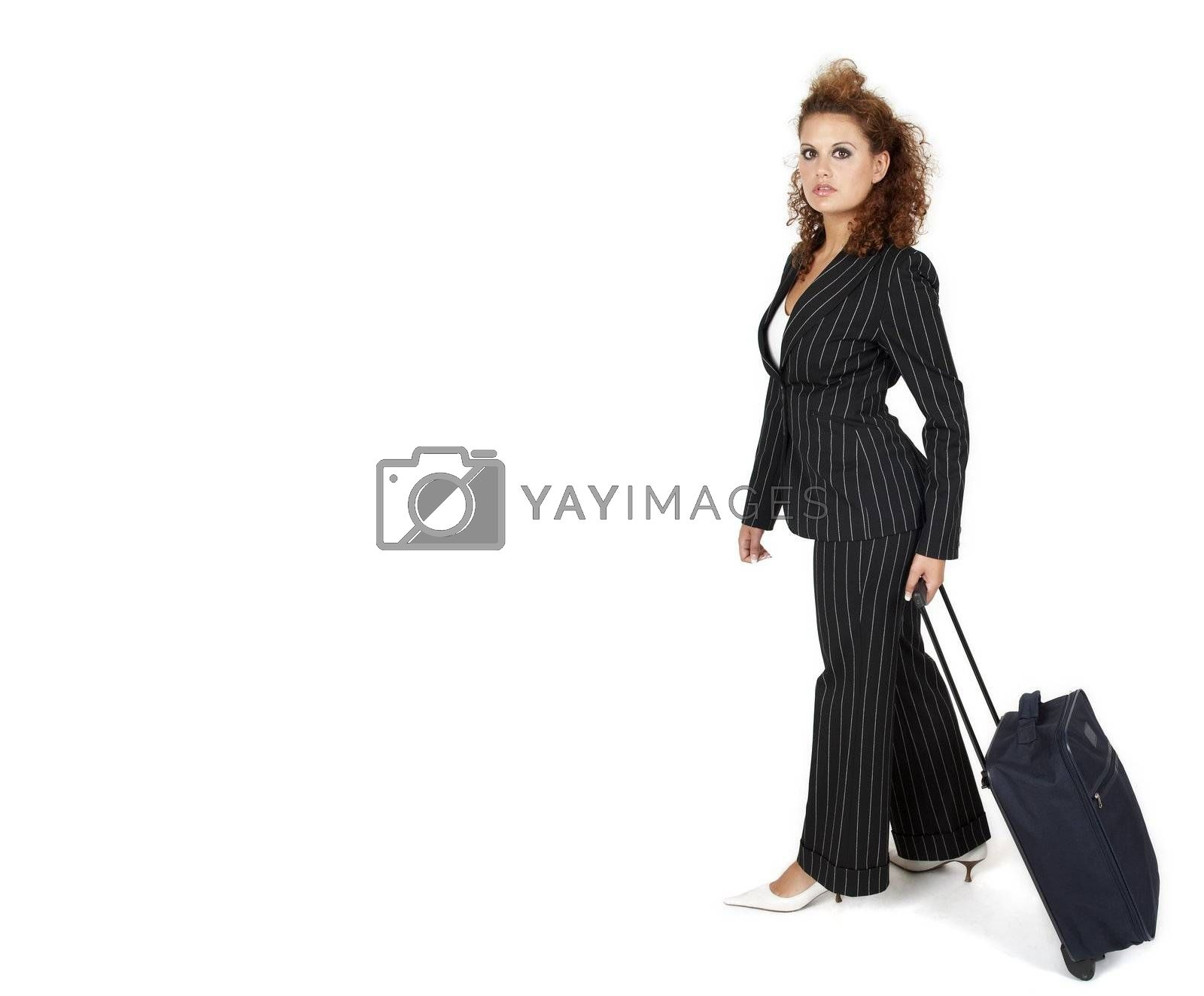 Businesswoman pulling her luggage, isolated on white background; copy space.