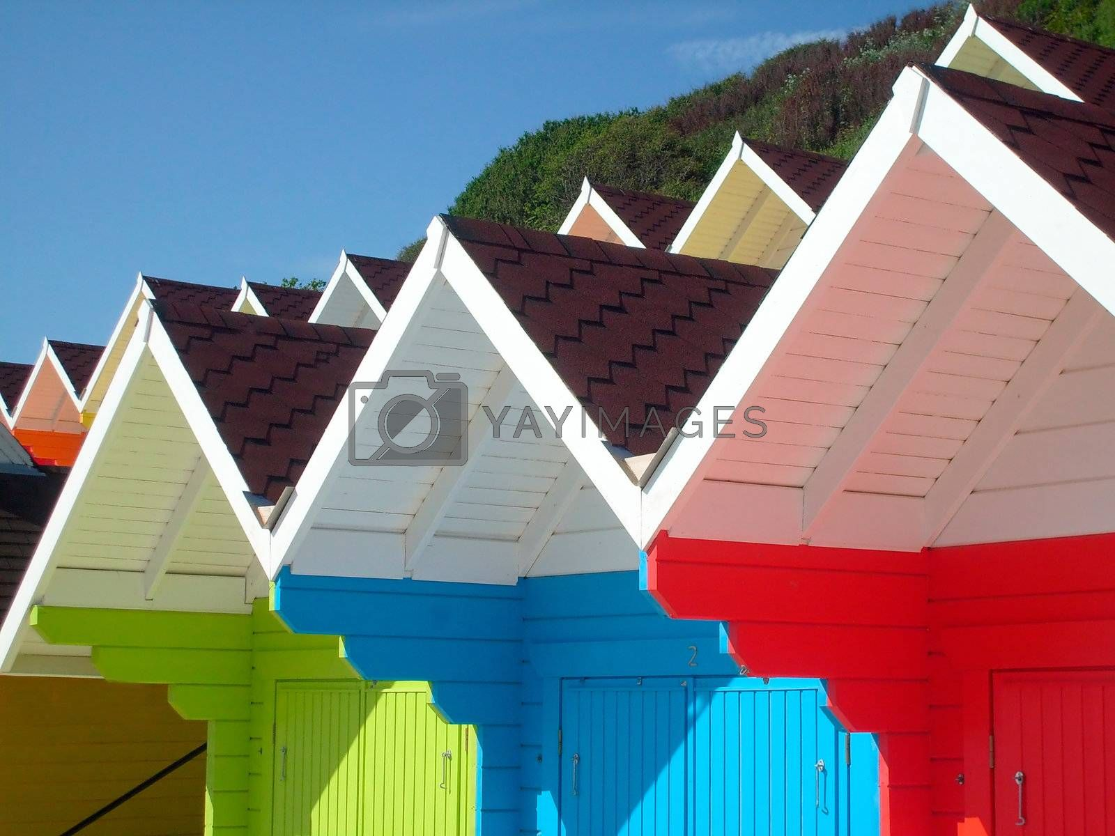 Colorful seaside beach chalets by speedfighter