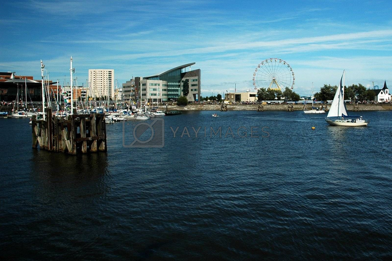 cardiff bay with blue sky, white clouds, horizontally framed shot