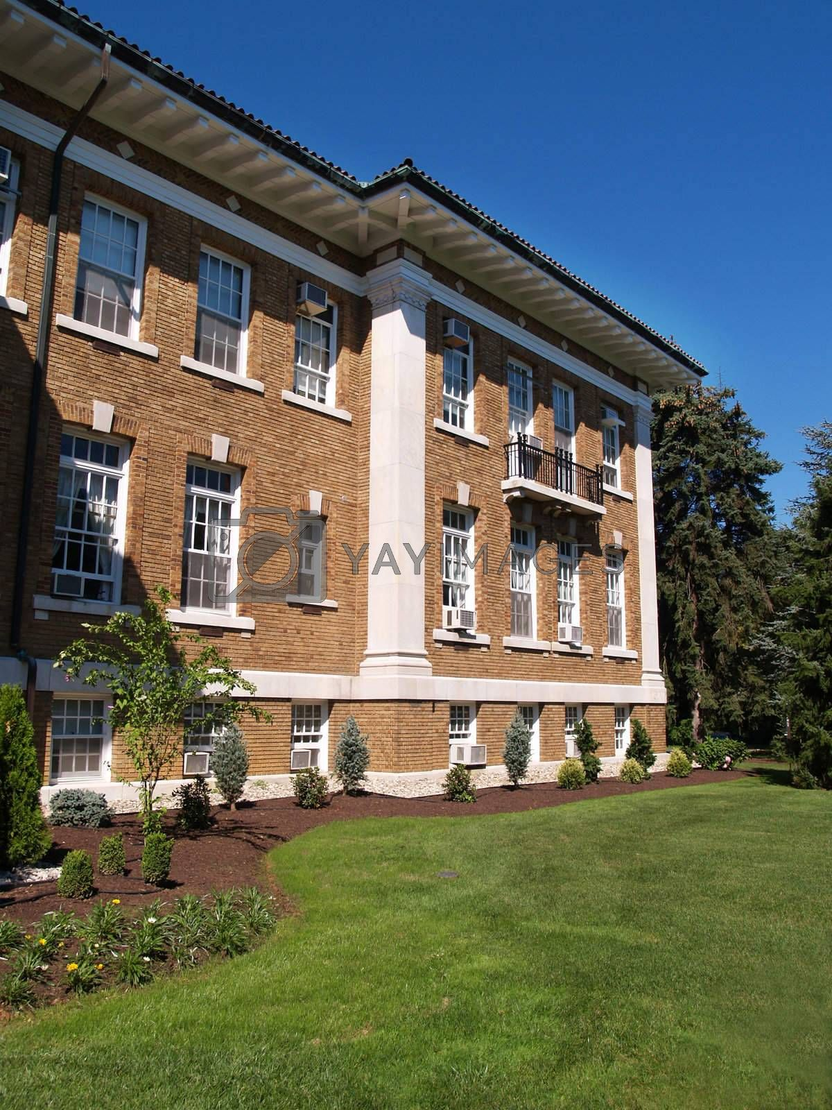 exterior of an old red brick building on a college campus