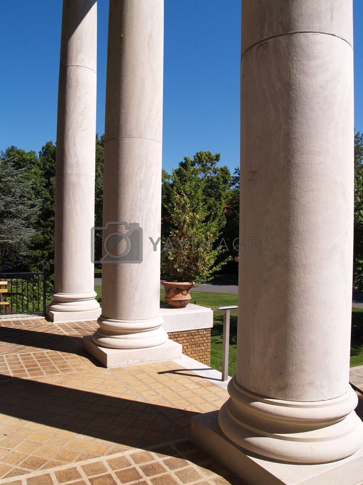 Royalty free image of large white porch columns by cfarmer