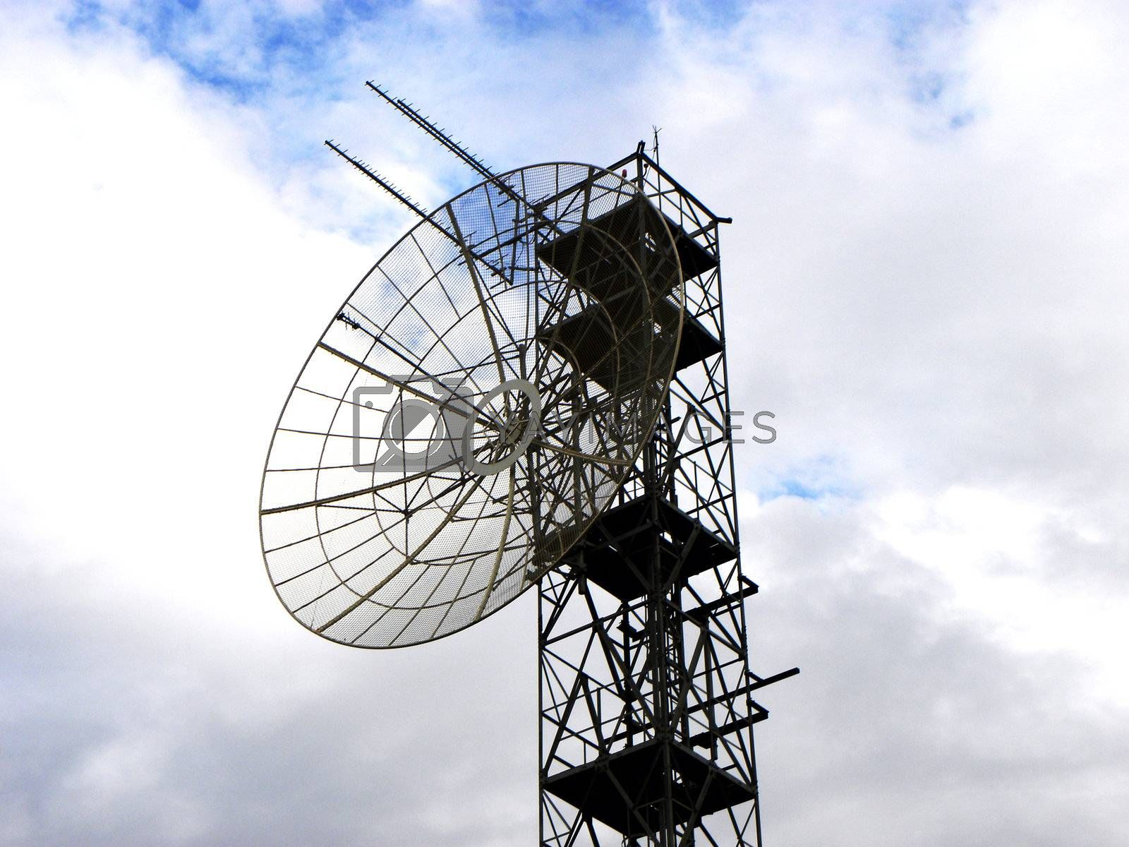 contrast of light in the image of antenna pointing at the sky. Represents the technology and the modern world and the Internet, cable television, cell phones and other