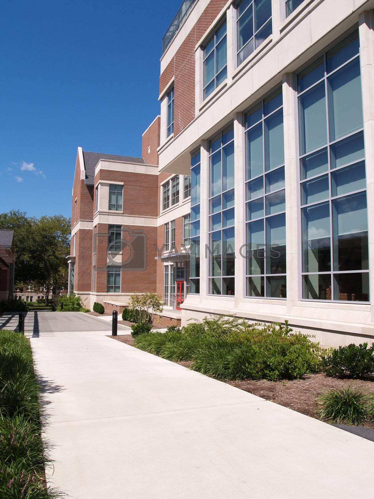modern brick building with many glass windows
