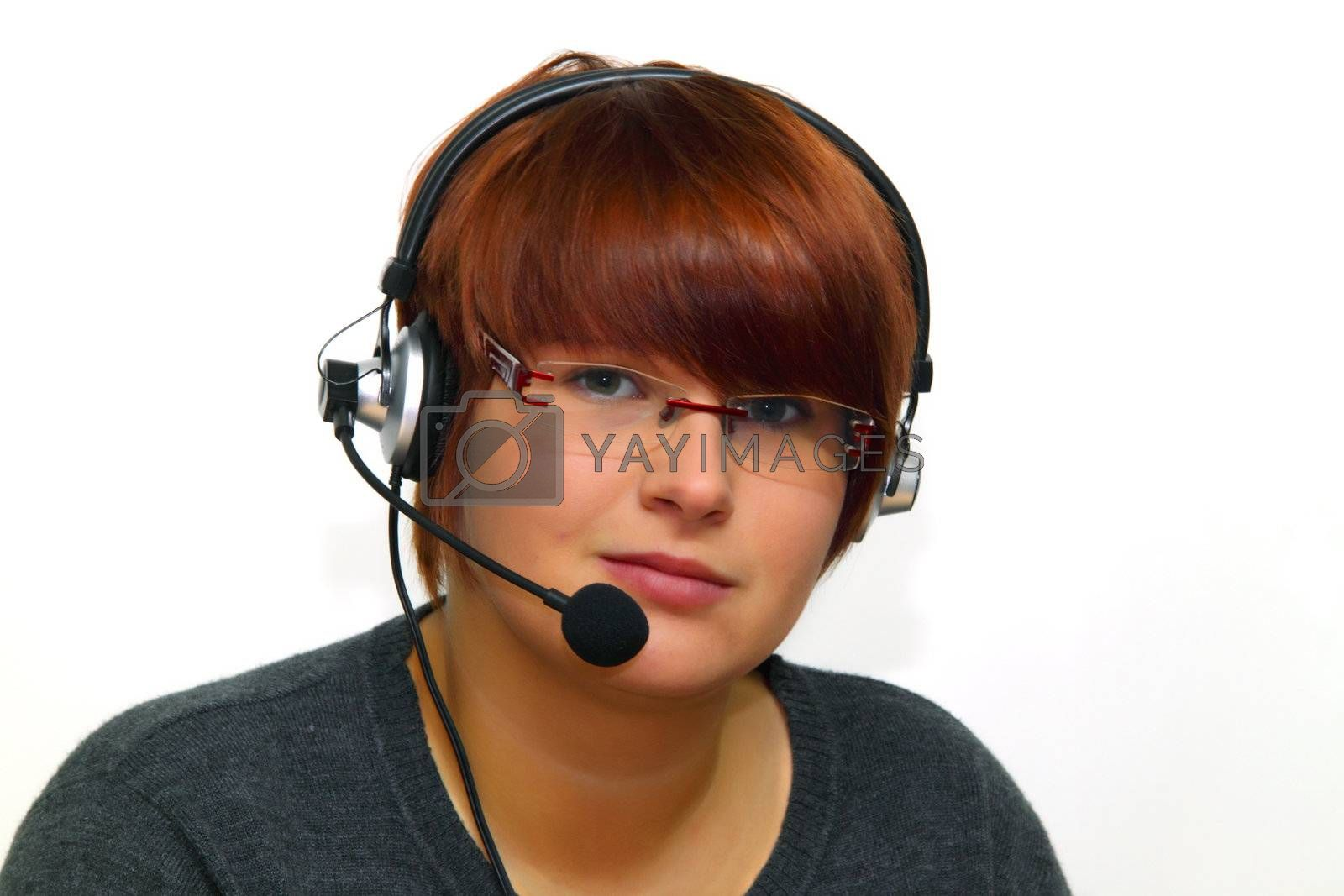 Portrait of young woman with headset, on white background, smiling.