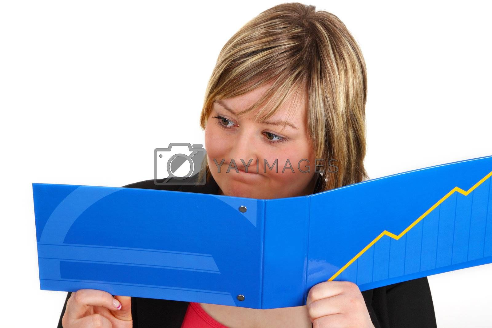 Young woman looking shocked at statement of account. Shot in studio.