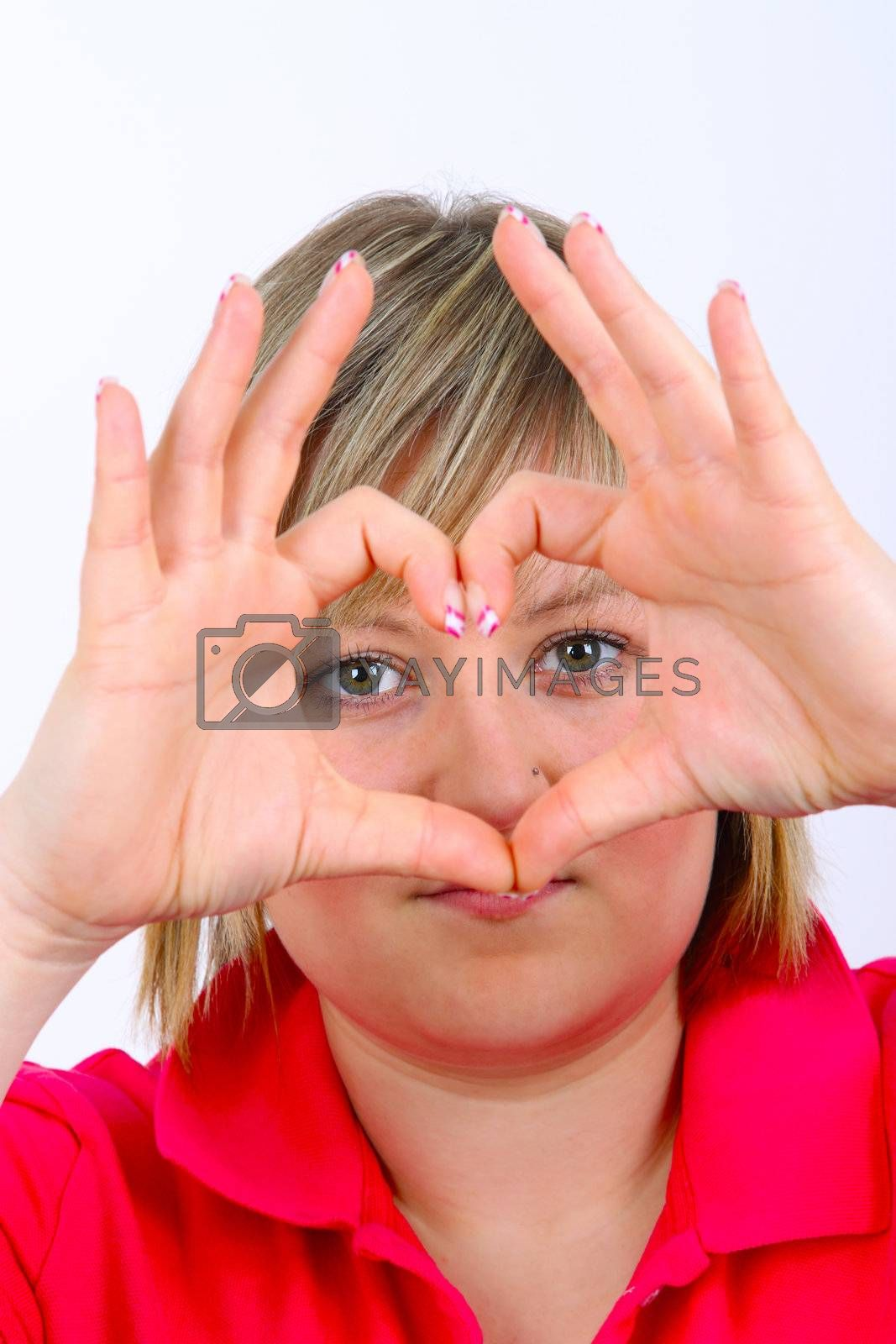 Young woman hand signal showing heart on white background