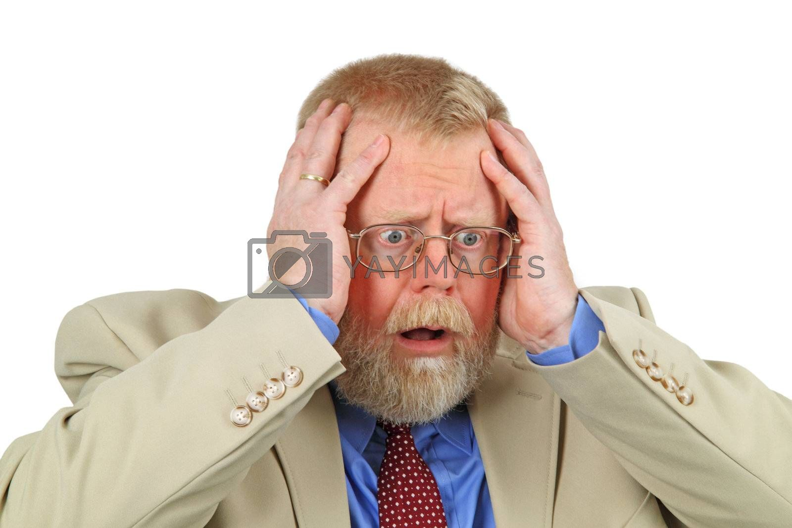 Close up portrait of distressed businessman with hands on his face, white background.