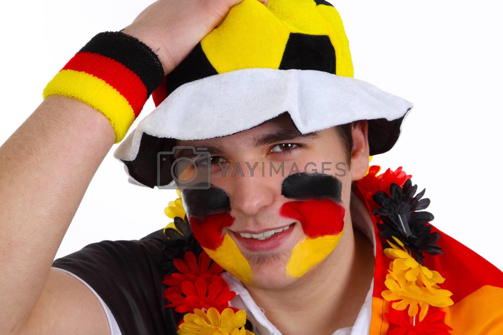 German soccer fan on white background. Shot in studio.