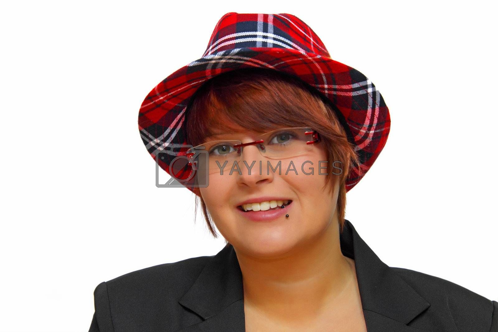 Portrait of an attractive young woman wearing a checkered hat.