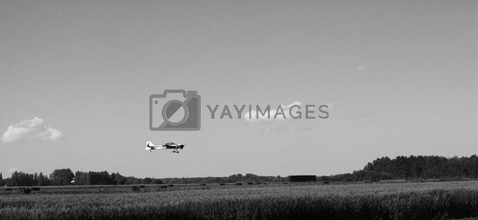 A small remote controlled plane landing in a field