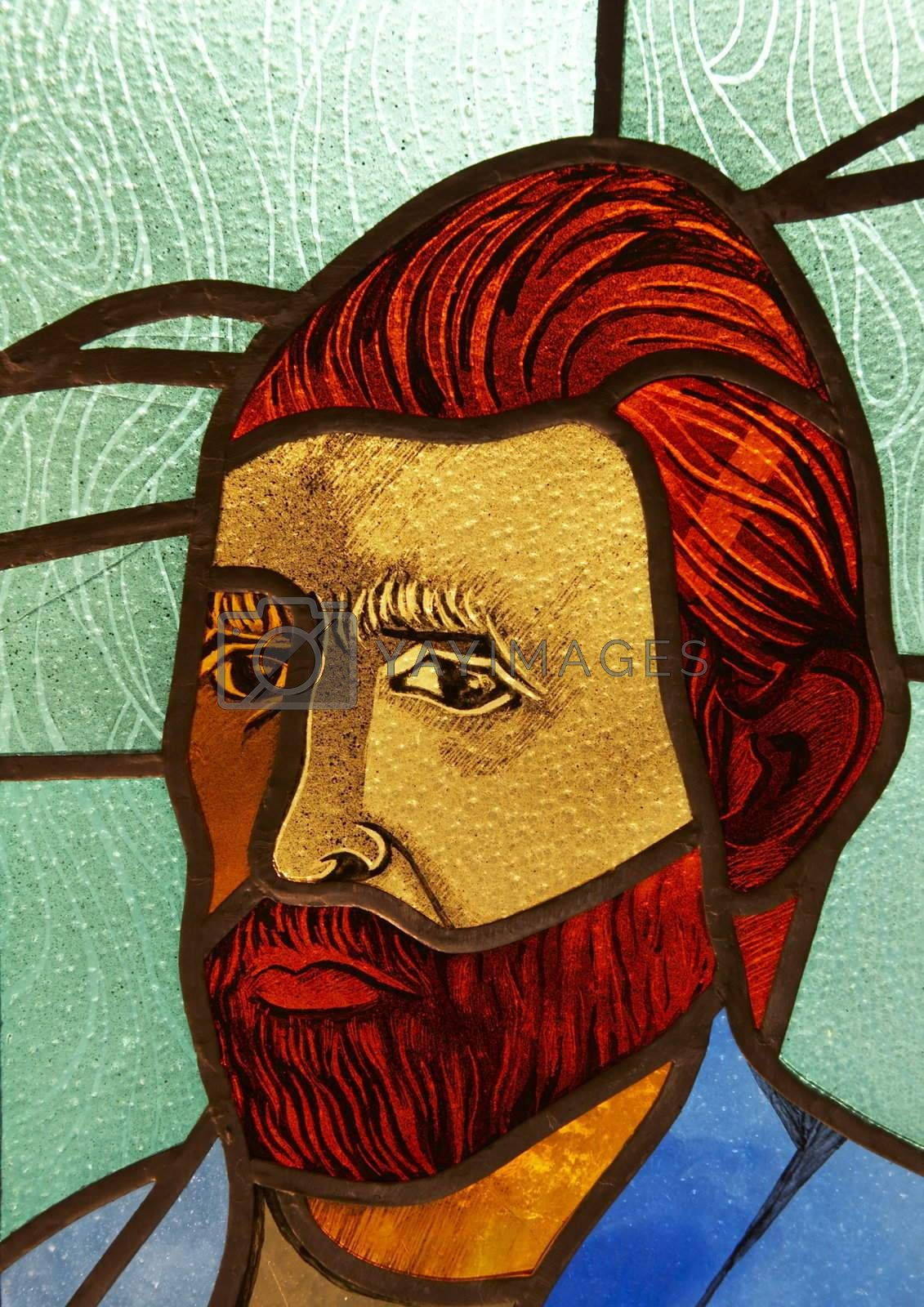 Stained glass with man portrait