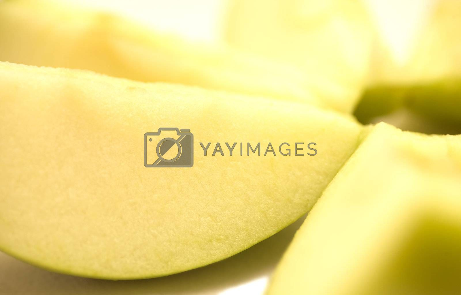 A few slices of apple on a white background