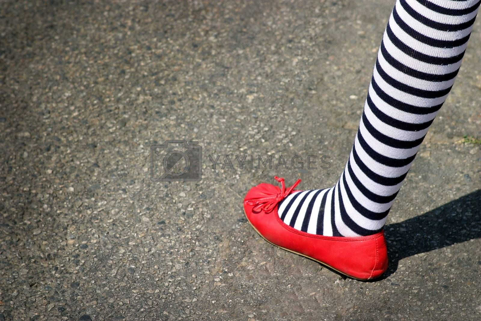 Patriotic foot with red shoe and blue white striped sock.