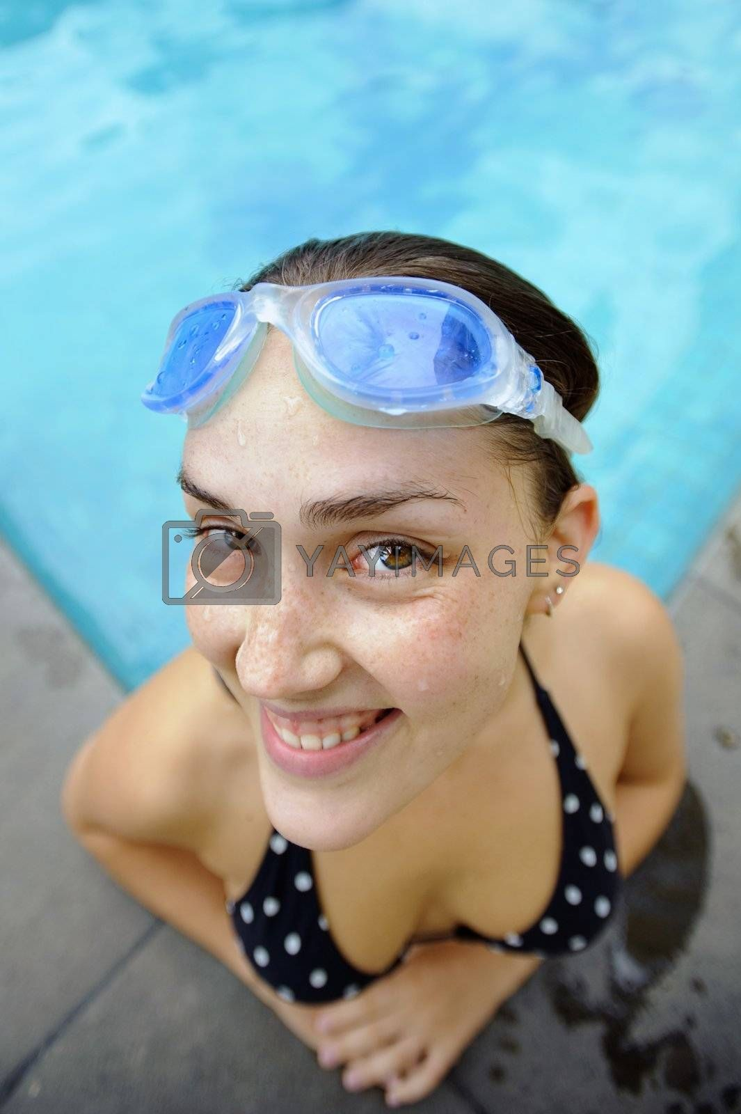 Female smiles with goggles on her head