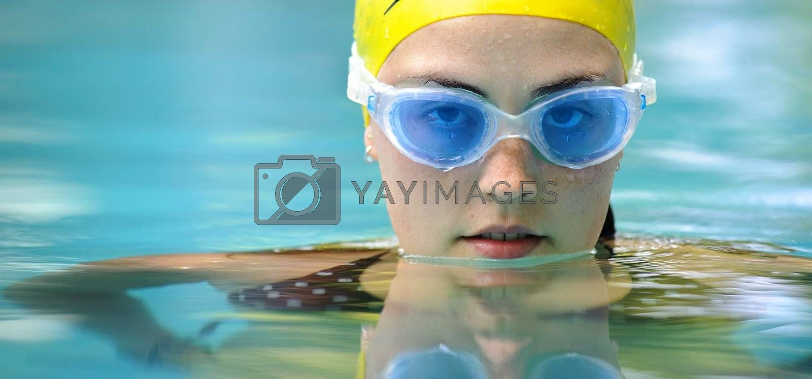 Swimmer looks towards camera while in the water