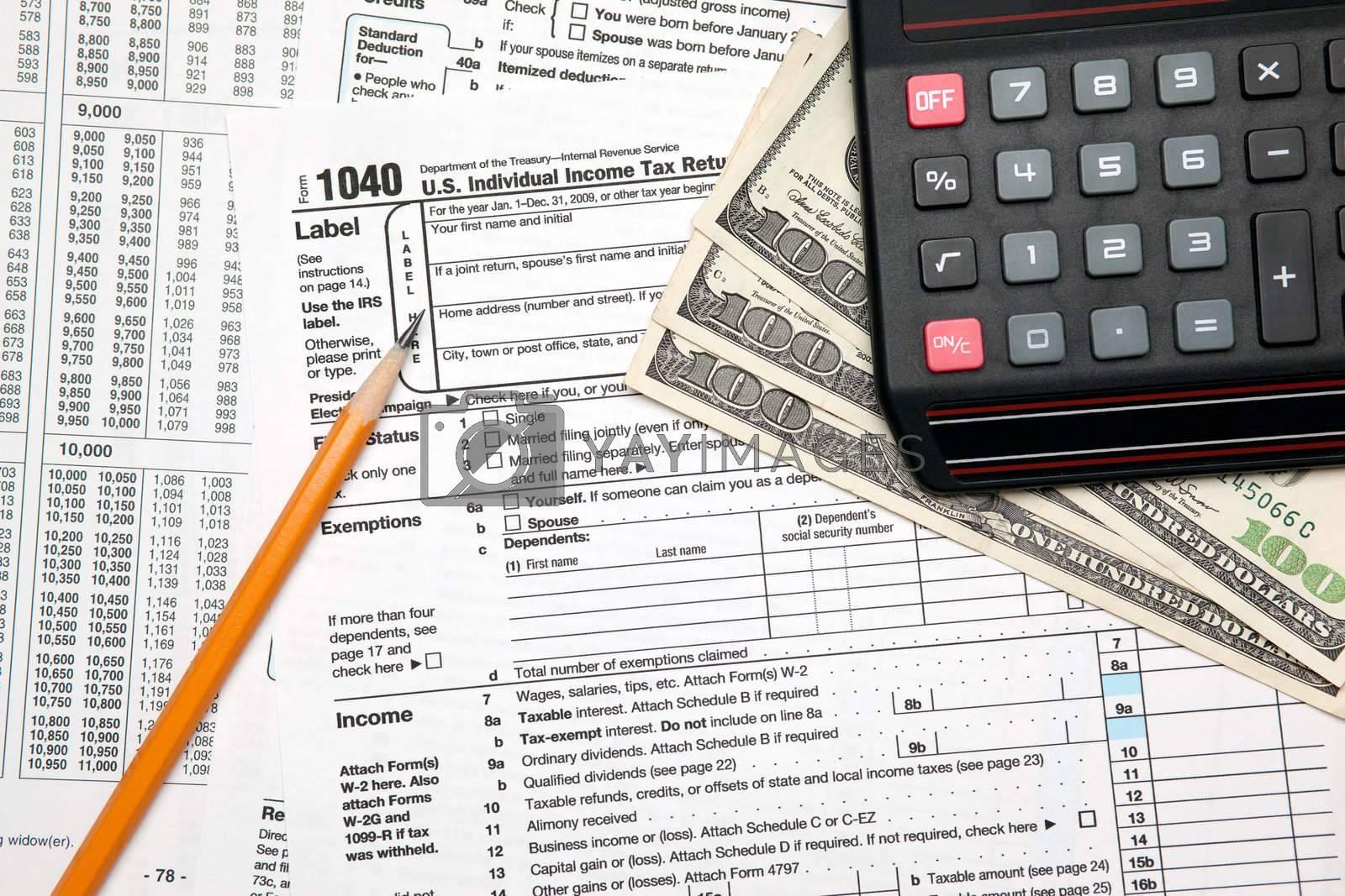 Tax time - U.S. 1040 tax return with pencil and calculator by svanblar