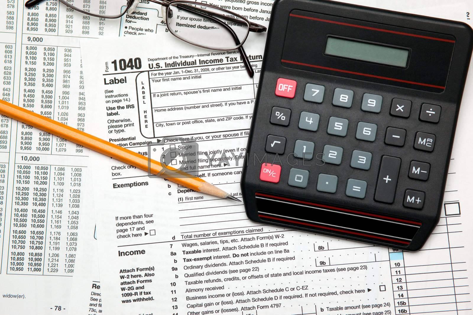Tax time - Closeup of U.S. 1040 tax return with pencil, glasses  by svanblar