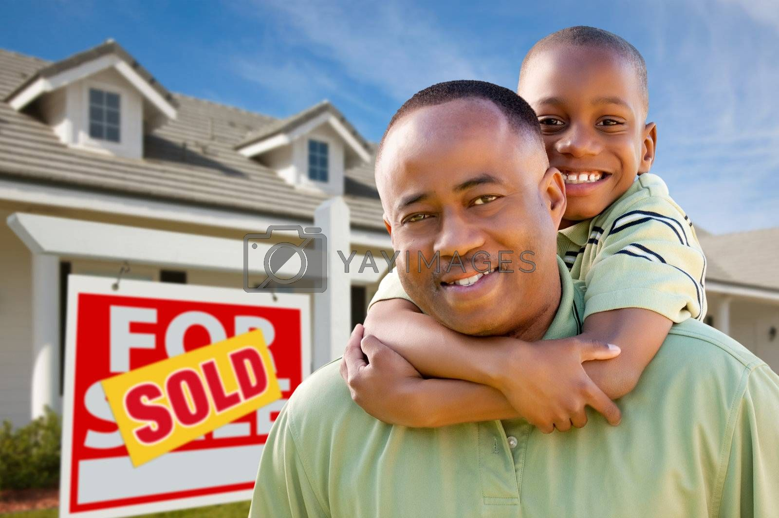 Royalty free image of Father with Son In Front of Real Estate Sign and Home by Feverpitched