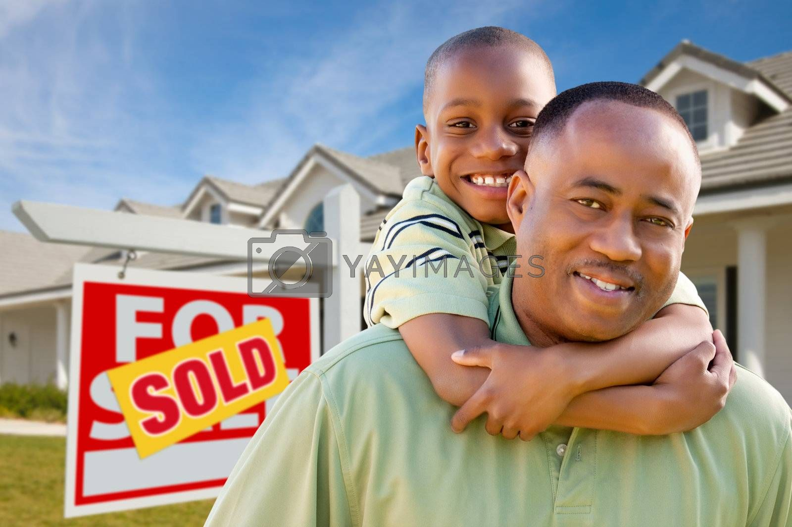 Father with Son In Front of Real Estate Sign and Home by Feverpitched