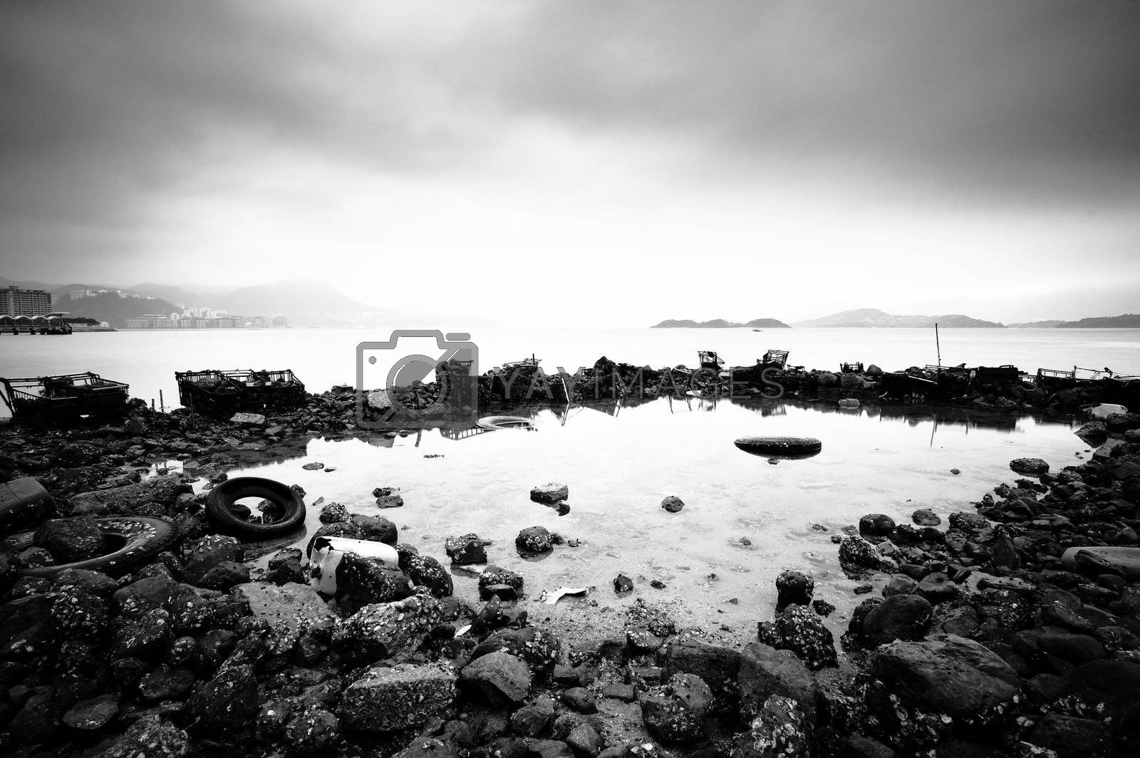 some wasted stuffs at the coastline by leungchopan