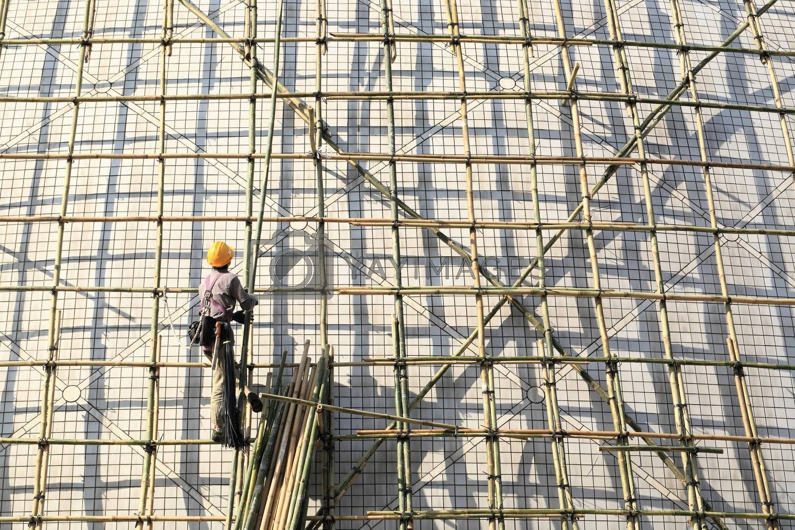 Royalty free image of building a scaffold with bamboo by leungchopan