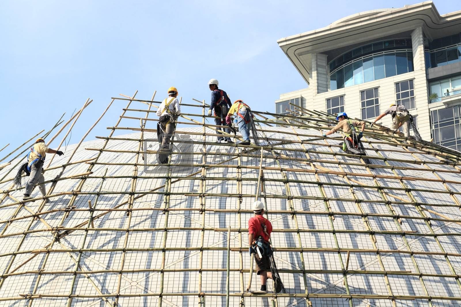 building a scaffold with bamboo by leungchopan
