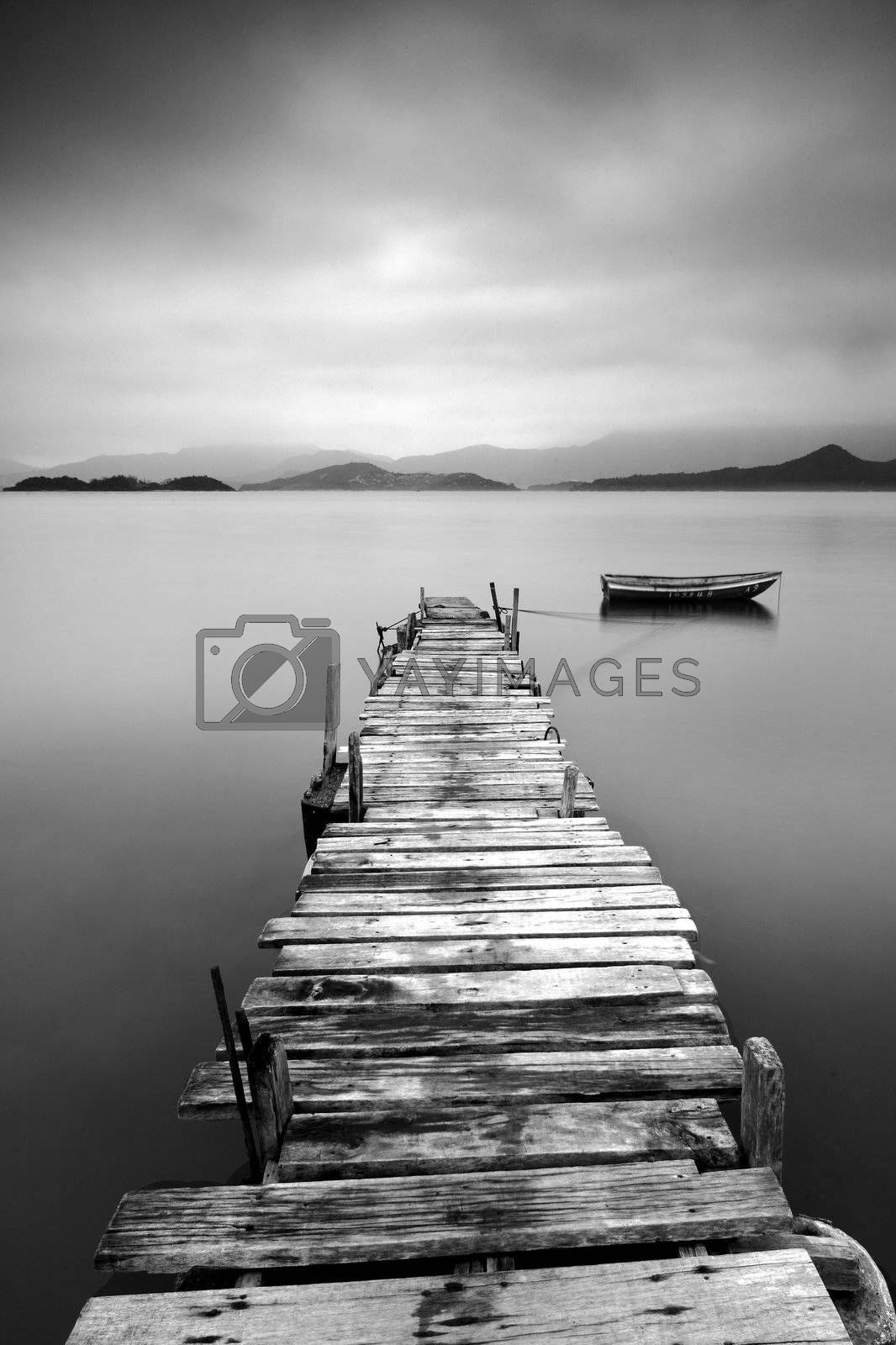 black and white peer with boat by leungchopan