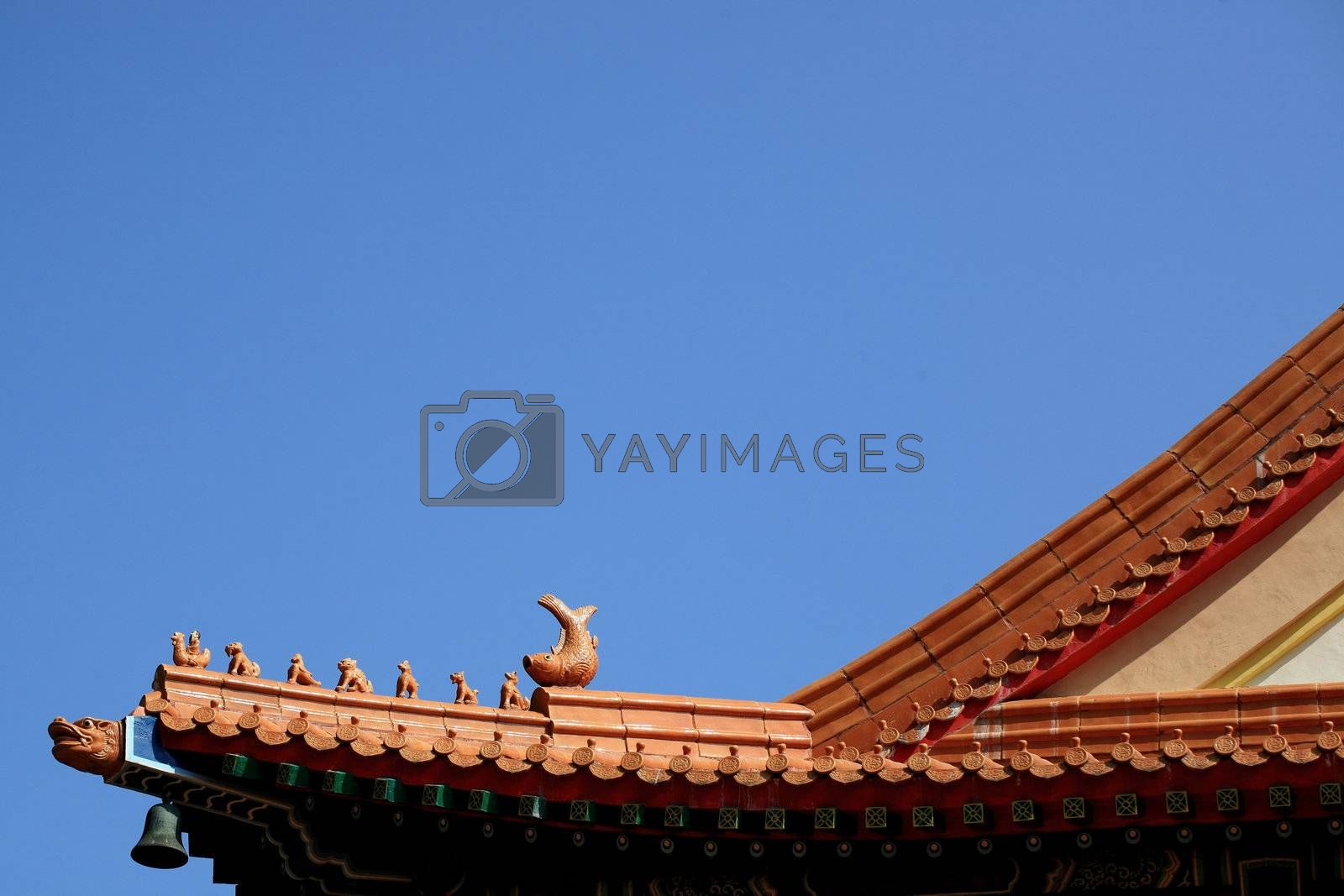 Royalty free image of chinese temple roof by leungchopan
