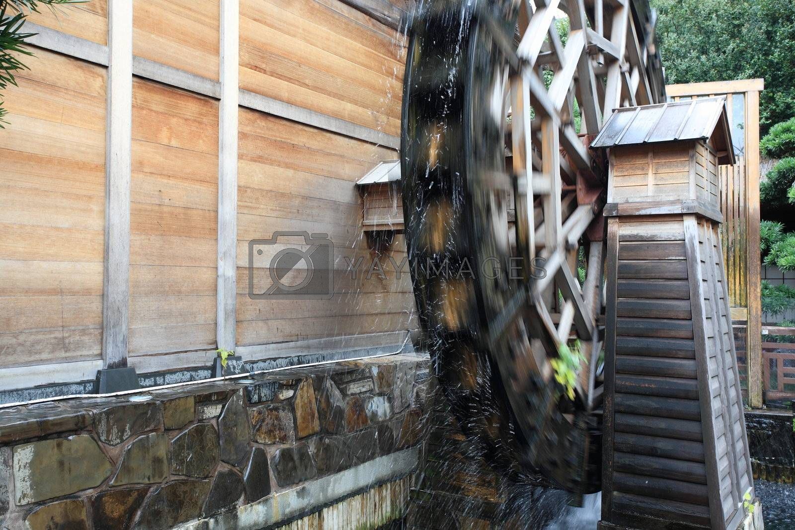 Royalty free image of wooden waterwheel  by leungchopan