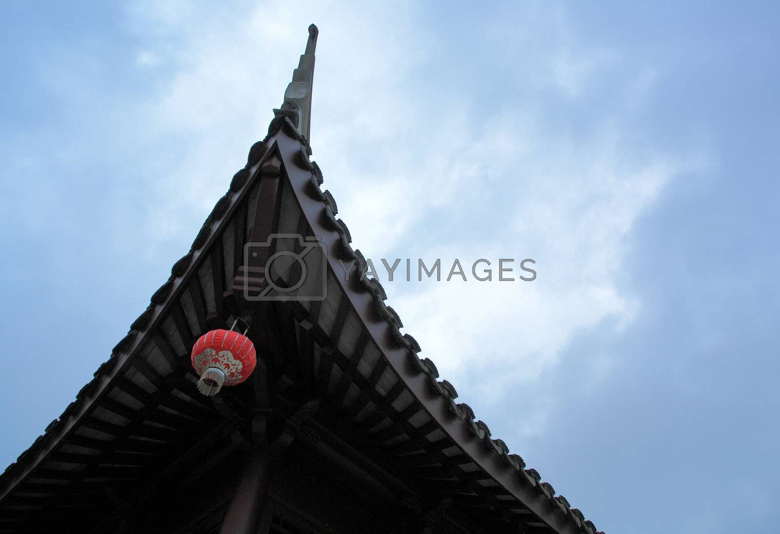 chinese roof with a lantern by leungchopan