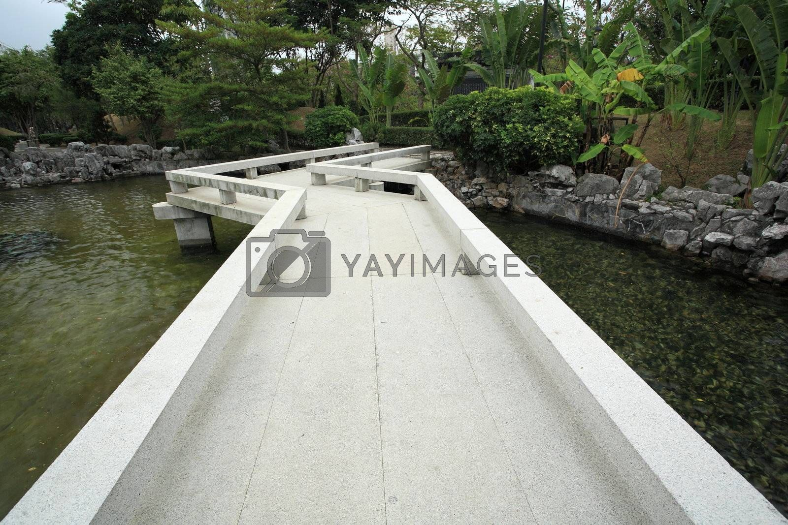 Royalty free image of bridge in chinese garden by leungchopan