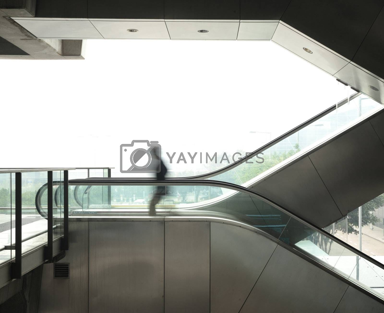 business man move on escalator by leungchopan