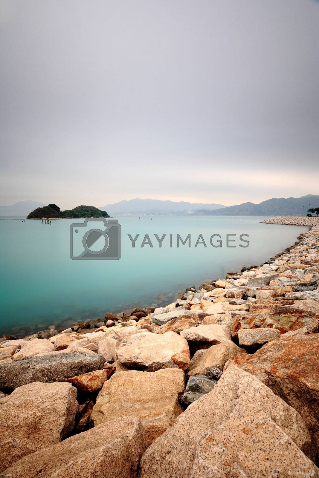 Royalty free image of peaceful water bay by leungchopan