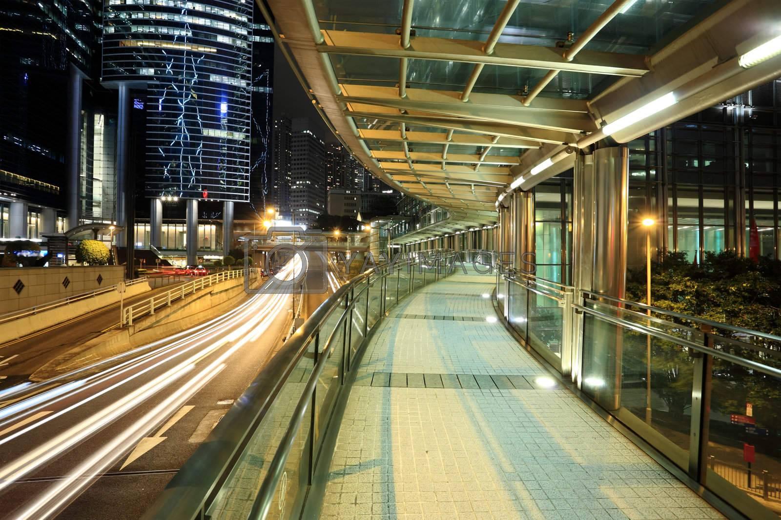 Royalty free image of a modern footbridge at night by leungchopan