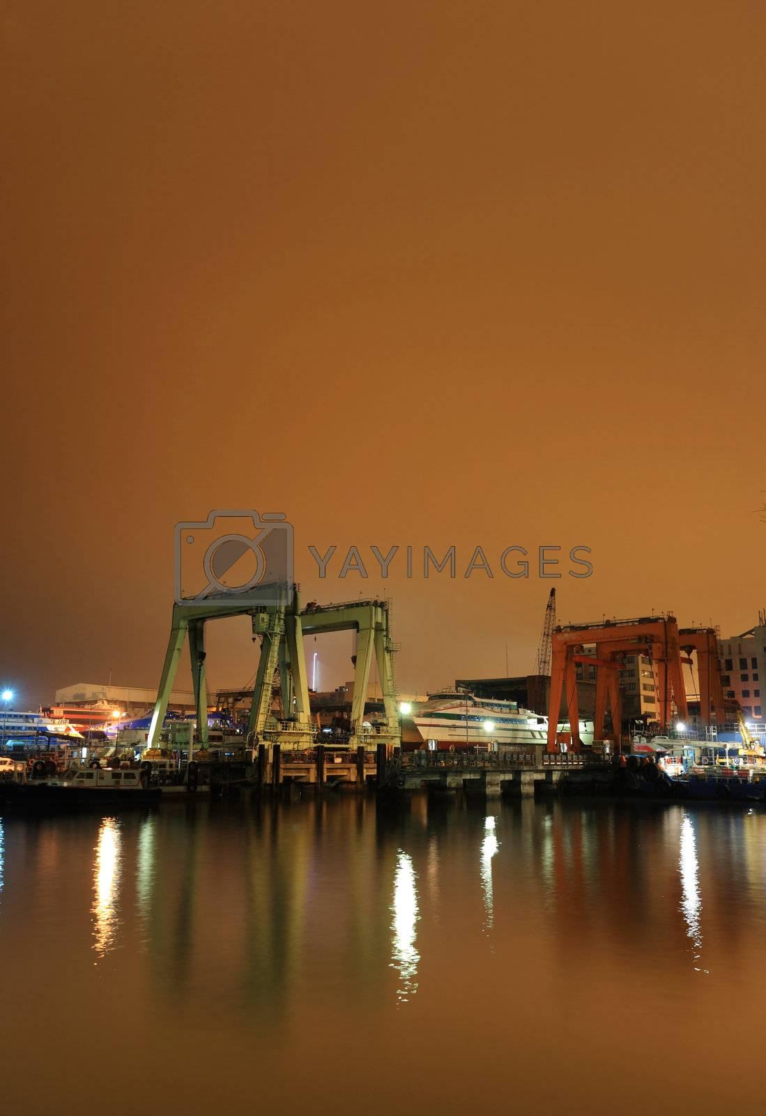 Royalty free image of dock at night by leungchopan
