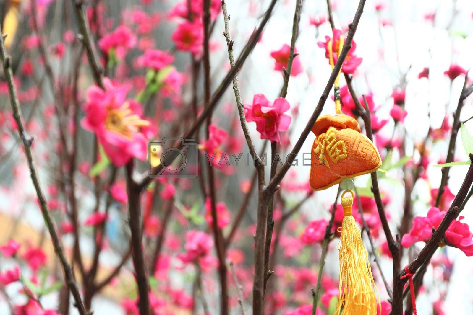 Chinese new year decoration--Yellow fortune bag and peach blossom by leungchopan
