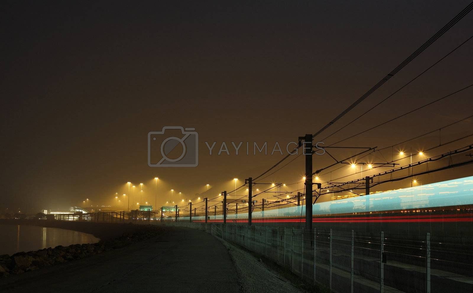 Royalty free image of railway at night by leungchopan
