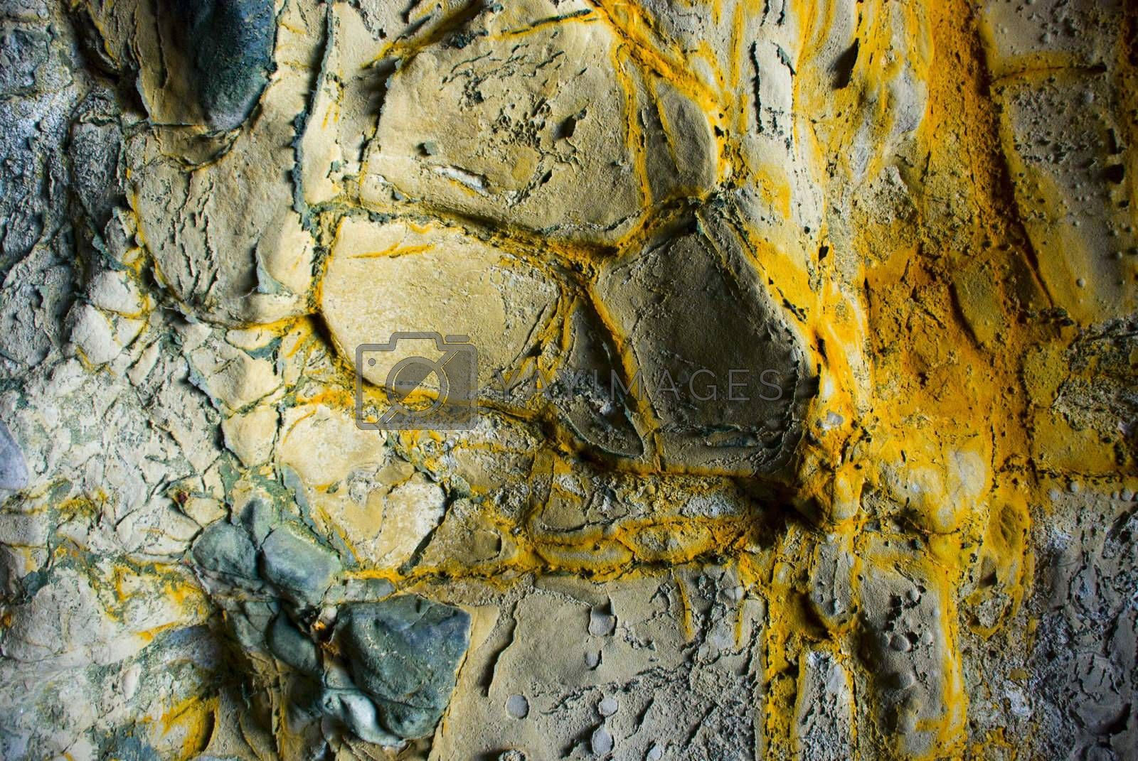 Yellow minerals on a rock formation