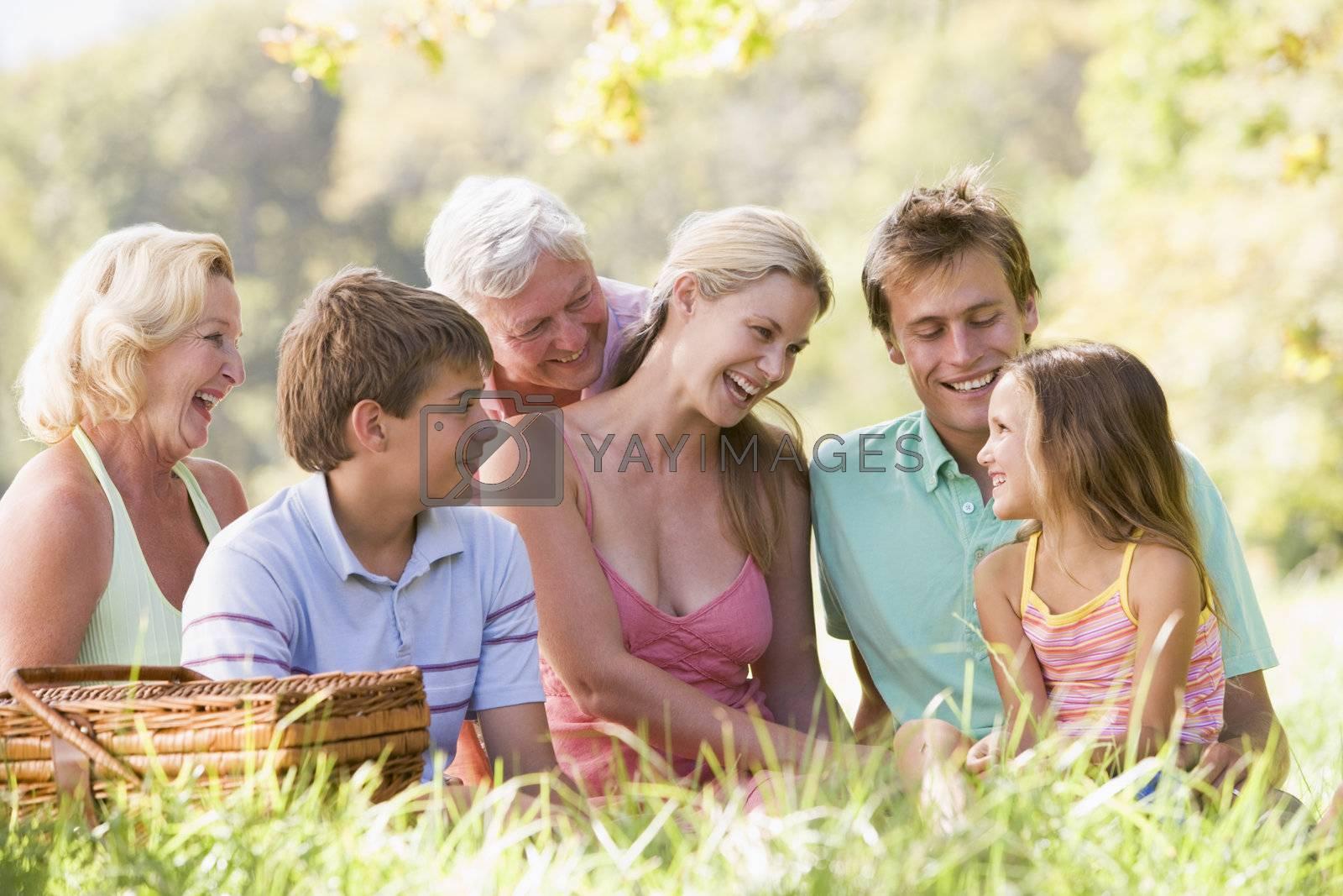 Family at a picnic smiling