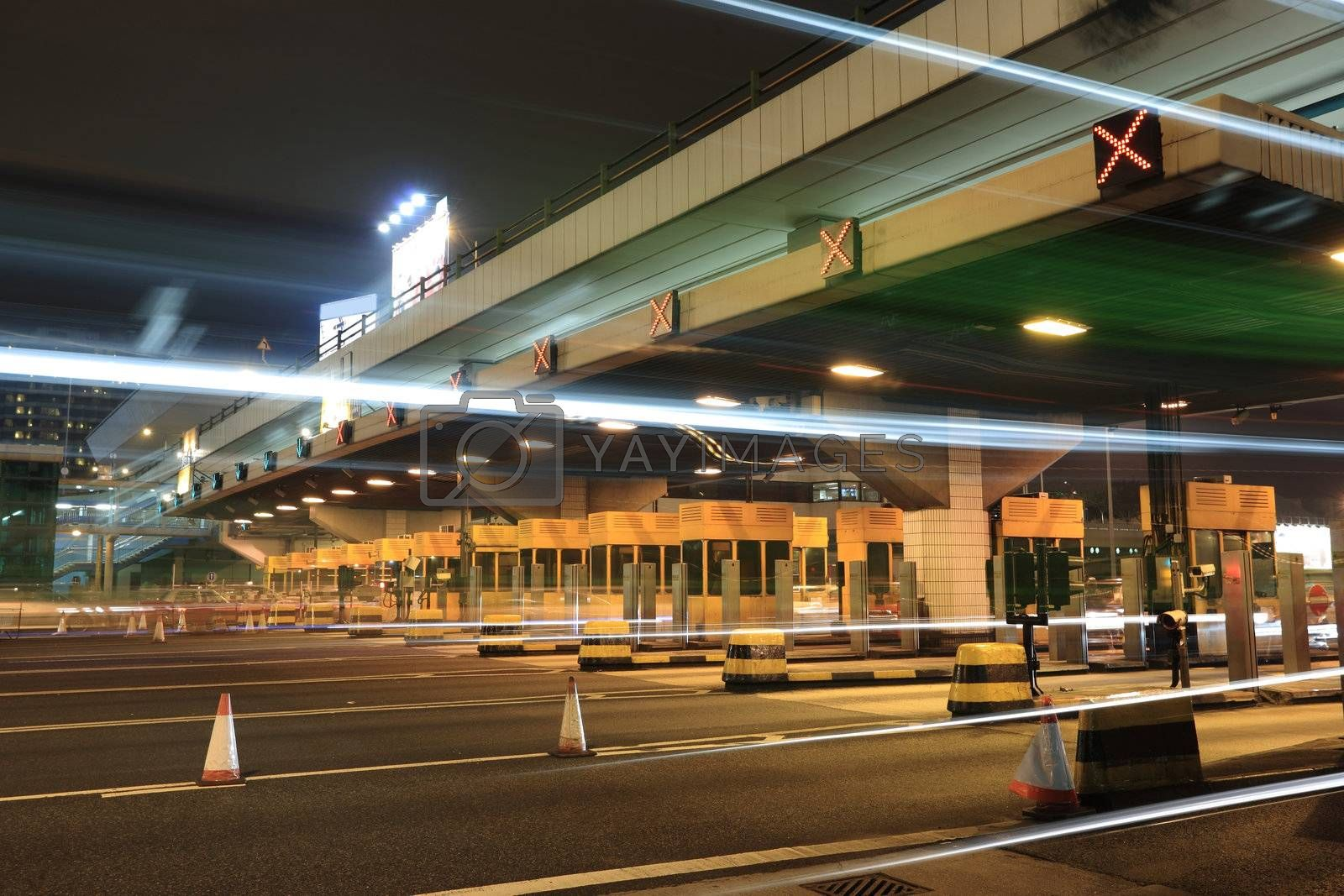 toll booths with car light in Hong Kong by leungchopan