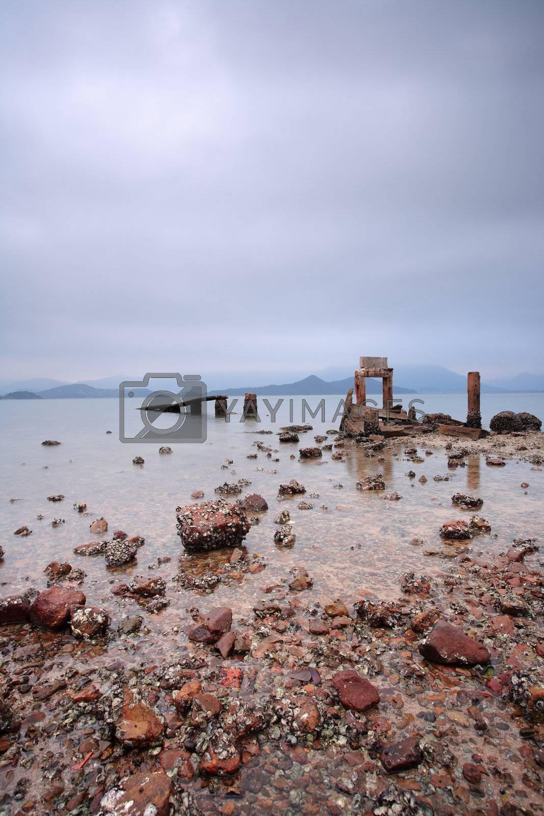 Royalty free image of broken pier by leungchopan