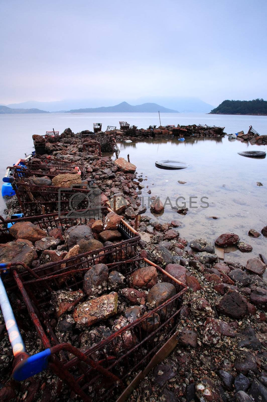 wasted stuffs at the coastline by leungchopan