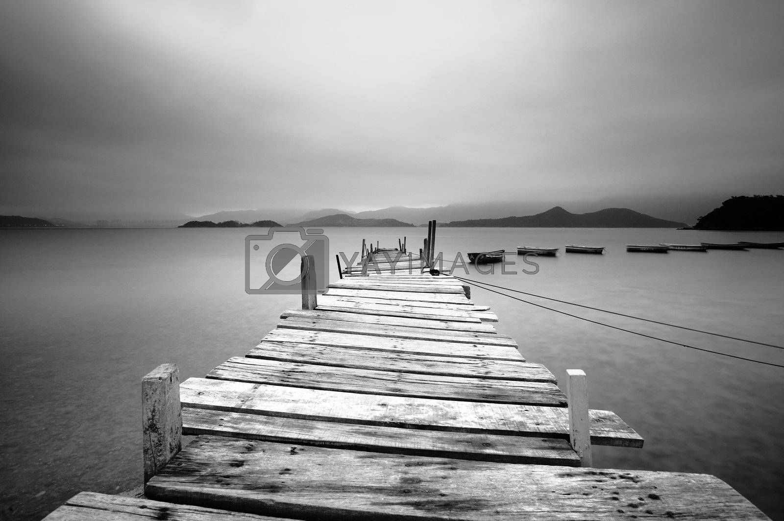 Royalty free image of Looking over a pier and boats, black and white by leungchopan