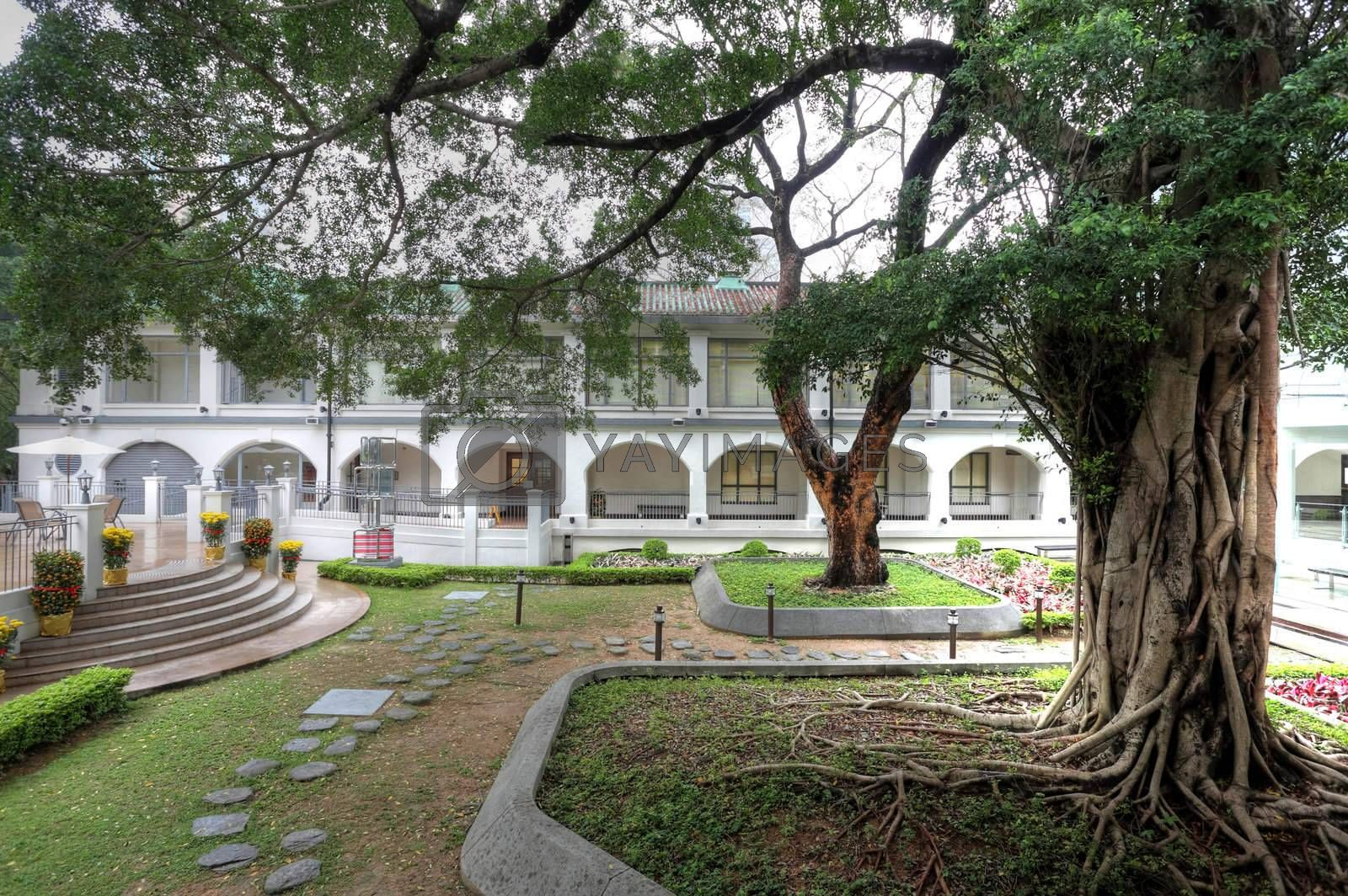 Royalty free image of British building in Hong Kong with garden by leungchopan
