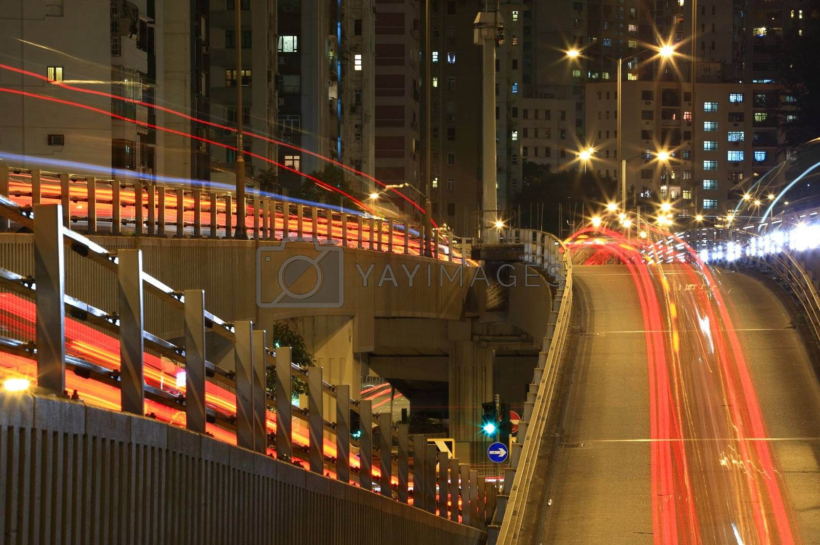 Hong Kong freeway system at night by leungchopan